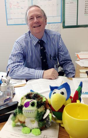 Dr. Enlow shares his desk.