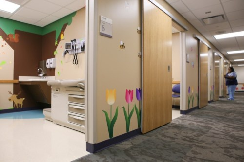 Sliding doors take up less space than traditional swing doors on exam rooms.