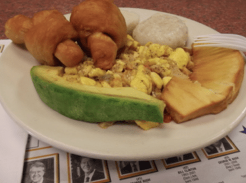Breakfast (Jamaica) of ackee, salt fish, dumplings, Johnny Cakes, roasted breadfruit and avocado