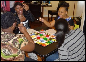 Players engage in 2 Sow or Not 2 Sow board game.