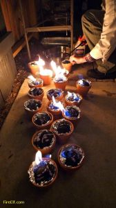 Light-Charcoal-In-Terracotta-Pots-Lined-With-Foil-For-Tabletop-S-mores--Fun-Backyard-Camping-party-Idea