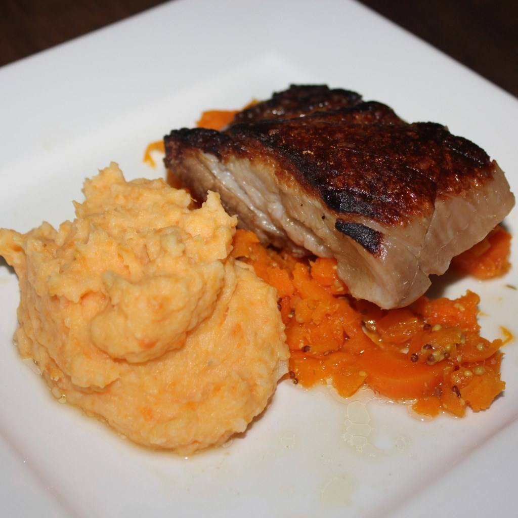 Crispy pork belly with mashed potato carrot and apple cider jus