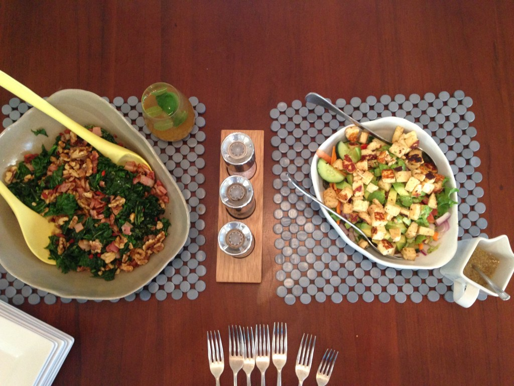 Shredded kale, bacon and walnut salad and a garden salad with avocado and haloumi