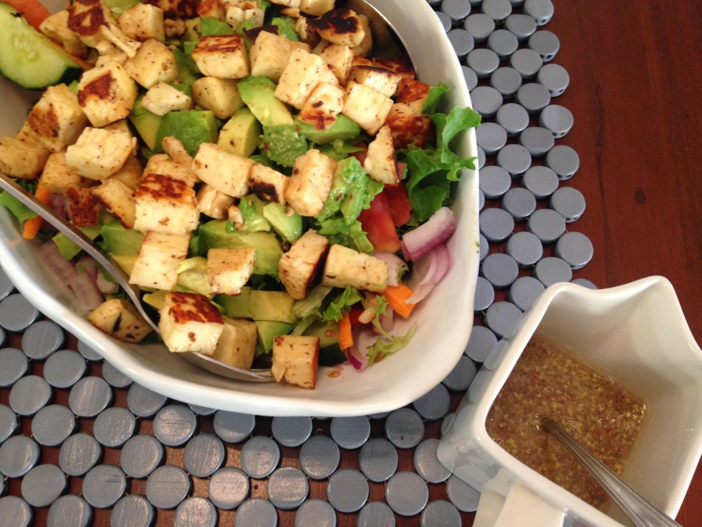 Garden salad with avocado and haloumi
