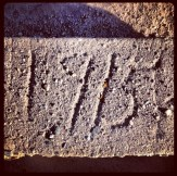 Year 1915 etched in concrete of North Fork Ditch at Folsom Lake