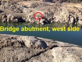 Within the red circle is the west side abutment. Suspension bridge water pipe landing on east side of American river.