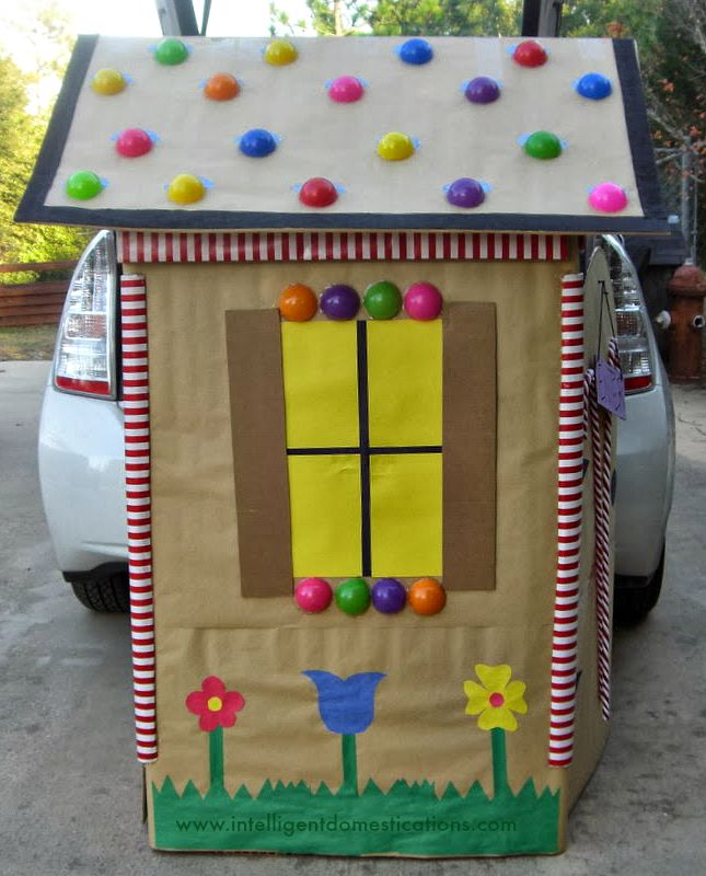 Trunk or Treat Candy Cottage made from a stove box. instructions at www.intelligentdomestications.com