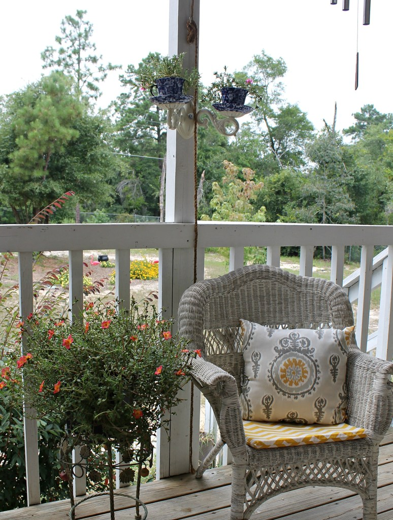 5.Porch Makeover included New seat cushions and pillows,Tea Cup Sconce Planter and pretty plants.intelligentdomestications.com
