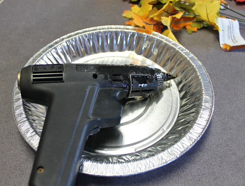A foil pie plate works great to hold the hot glue gun.intelligentdomestications.com