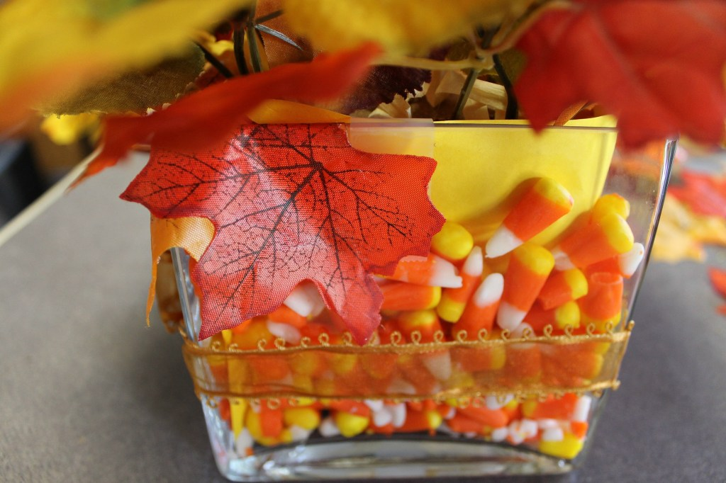 Glue the loose leaves onto the edge of the vase with hot glue. intelligentdomestications.com