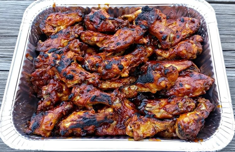 When you are cooking 10 lbs. of these lick your lips 3 Ingredient BBQ Wings, you'll want to pile them into a foil pan for easy transport to your event