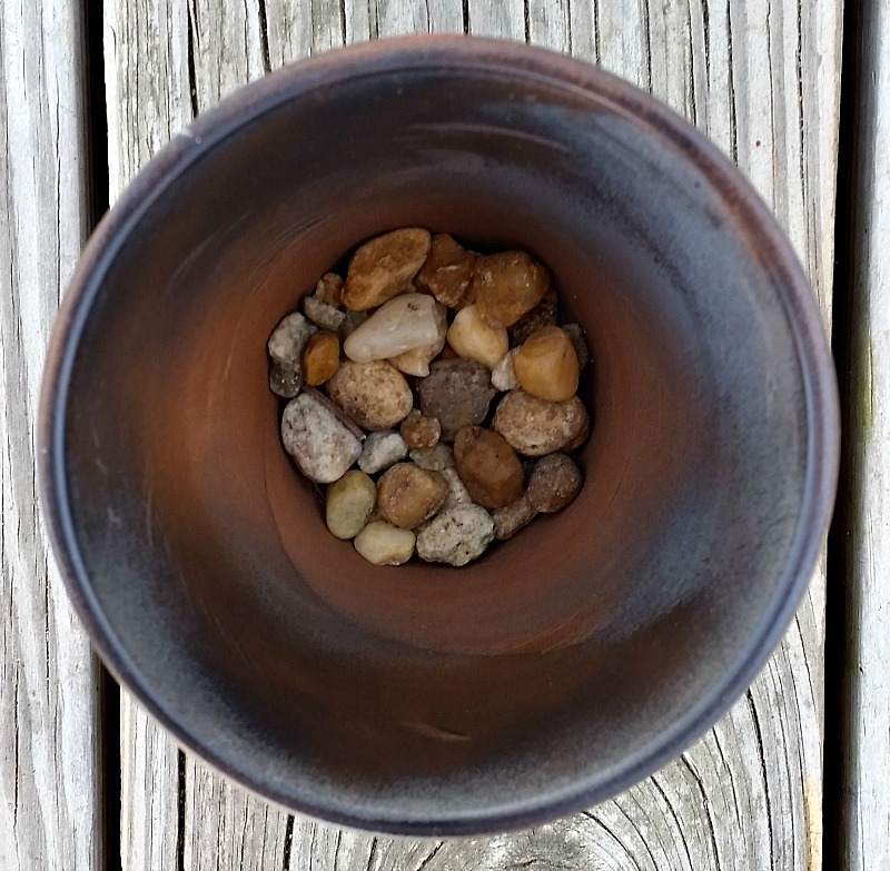Add rocks in the bottom of the pot before using for plants