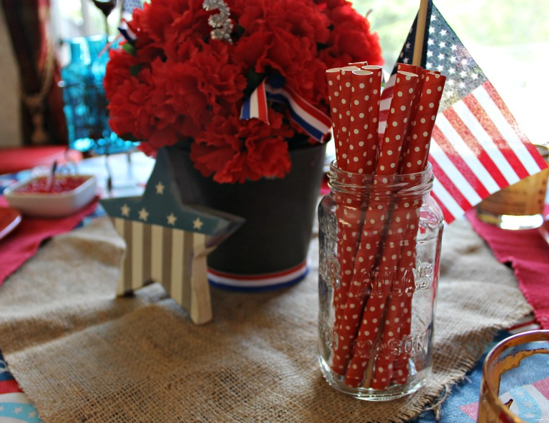 A vintage Mason jar is a nice addition to hold paper straws in my simple Patriotic tablescape