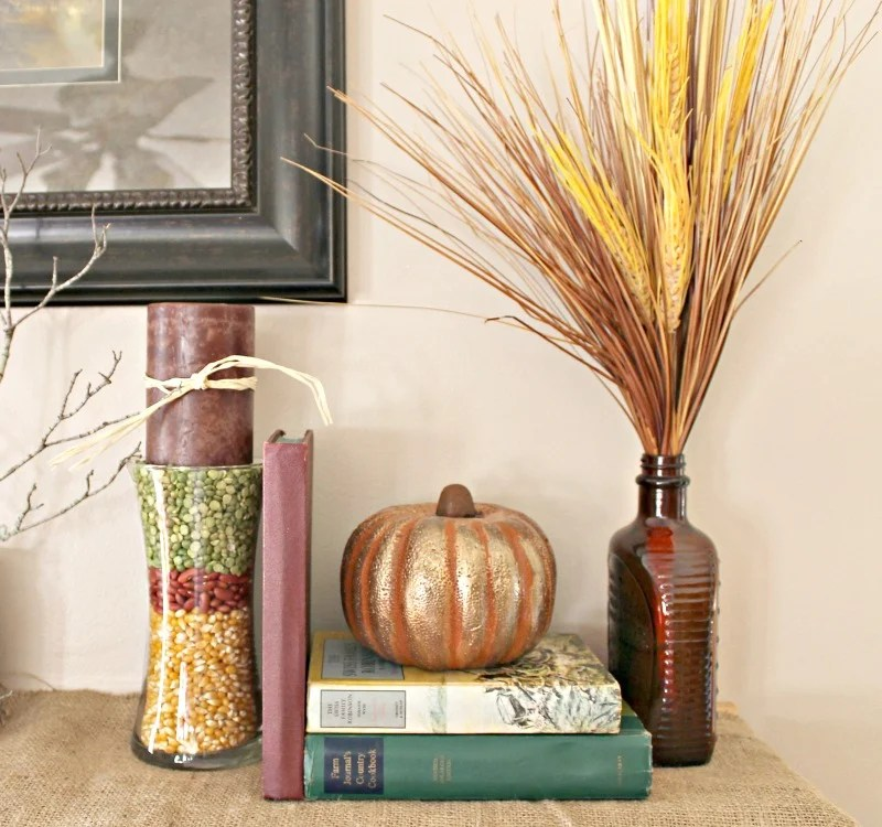 how-to-decorate-a-fall-mantle-with-books-pumpkins-and-glass-vases-at-intelligentdomestications-com