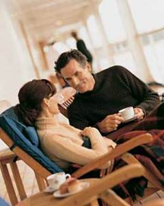 Couple having Coffee on Deck