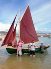 "Martin McMahon's 16'5"" Islay Skiff with student Jim Walsh and BBA Graduate and woman gig-builder Gail McGarva in waders"