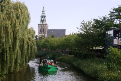 Jantje on the River Vechte, old church in the background