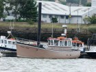 Harvest Queen looks like a converted wooden motor fishing vessel