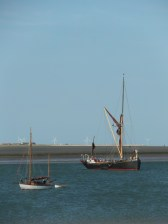 Swale match 2013 22 Firefly and sailing barge Lady Daphne at the bottom of the tide - note man in rigging