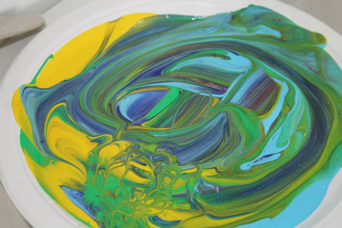 colours mixed in a paper plate ready to paint with bubble wrap