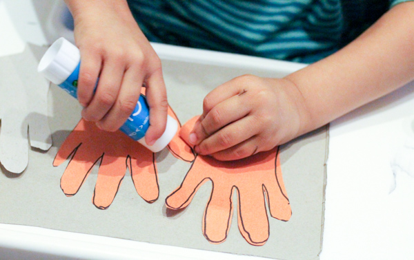 sticking down handprints