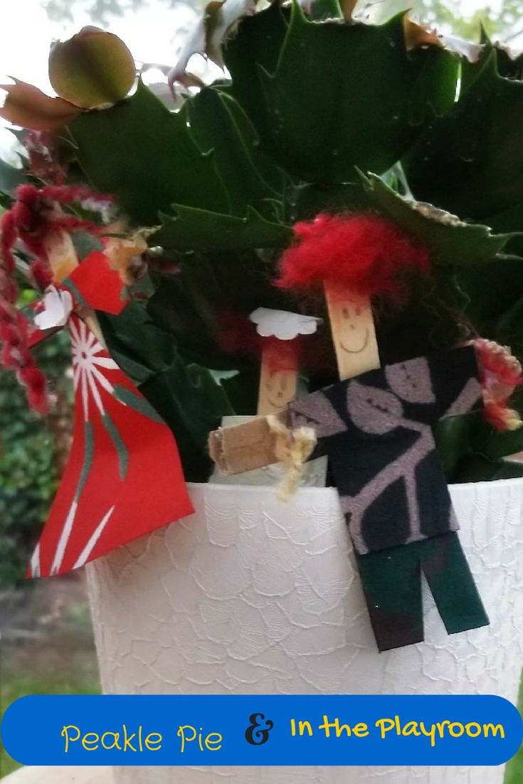 Scarecrows gardening craft made from craft sticks (lollibop sticks) and fabric scraps
