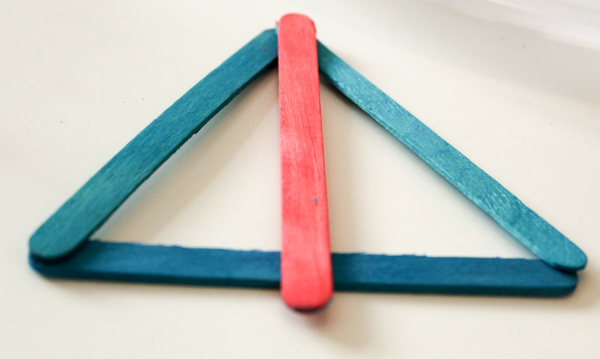 building 2d shapes and looking at their lines of symmetry, with craft sticks. Fun and simple STEM activity for kids