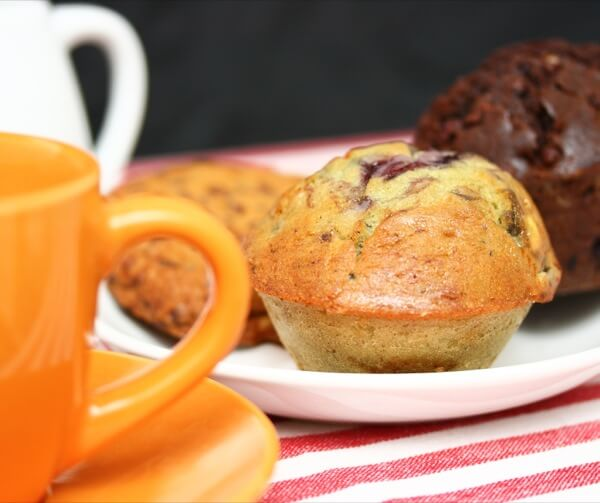 Chocolate And Blueberry Muffins Cookies And Coffee For A Snack