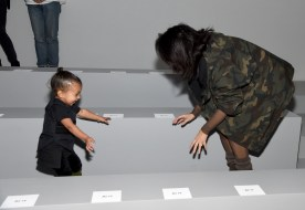 Kim Kardashian (R) and daughter North