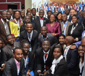 President Adesina poses for a photo with youth during the Africa Youth Entrepreneurship Forum at TICAD VI.