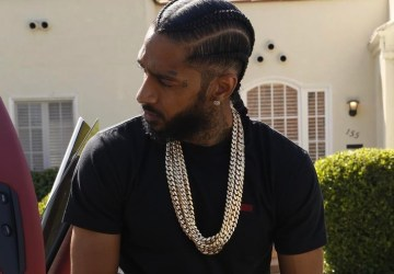 nipsey hussle tries to break up fight at his album release party