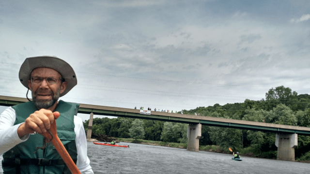 Lee Tesdell, after navigating his canoe past the County Highway E18 bridge. Photo: Gavin Aronsen/Iowa Informer