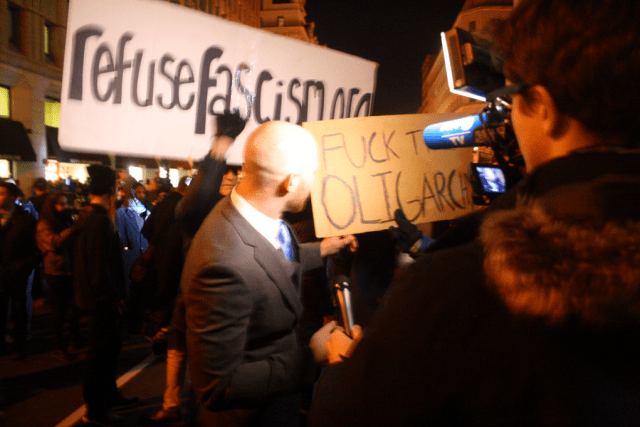 Protesters outside the alt-right's DeploraBall Thursday night at the National Press Club interrupt a Trump supporter doing an interview with the Agence France Presse. Photo: Gavin Aronsen/Iowa Informer