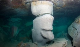 One of the Moai Heads underneath the Rapa Nui Reef - His head is buried in the sand.