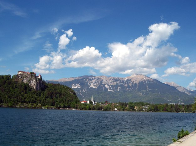 lake with castle and julian alps, bled, slovenia