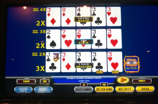 ultimate x video poker threes x 3