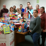 The IQ Inc. team and their 2015 donation to Toys for Tots