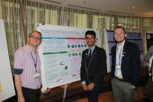 Dr. Gregory Phillips, Christian Adames, and Peter Lindeman show off their poster,