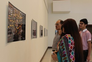 """Visitors at photo exhibition """"60 SOLUTIONS against climate change"""" in Islamabad. Photo: Sana Jamal"""