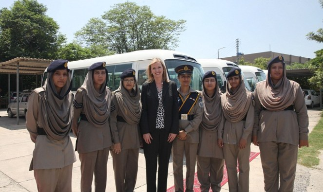 INL Director Katie Stana presents five mini buses to the Pakistan NH&MP Inspector General to provide transportation for women police officers