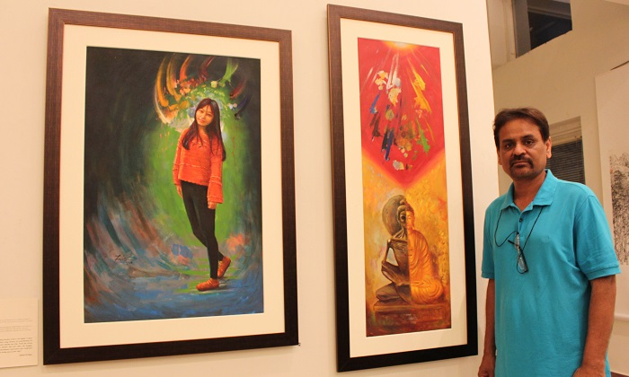 Pakistani artist Zahid ul Haq standing alongside his paintings at joint exhibition by Pakistani and Chinese artists at PNCA in Islamabad on 18 Oct. 2016. Photo: Sana Jamal