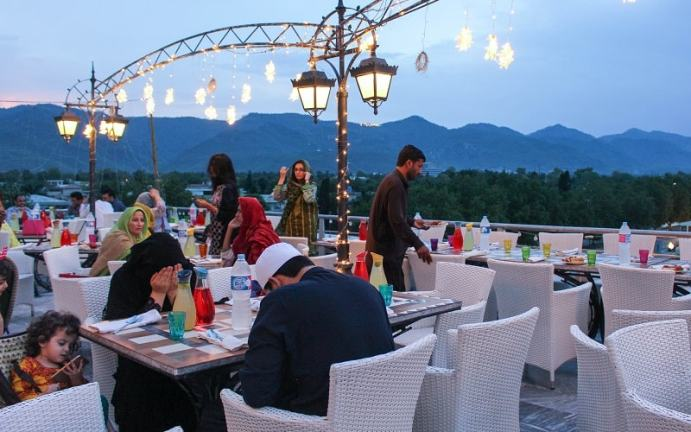 Evening Iftar time view of the La Terrazza terrace restaurant.