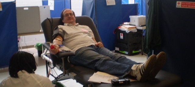 Khalid Asad of Frederick, MD donating blood at the fair