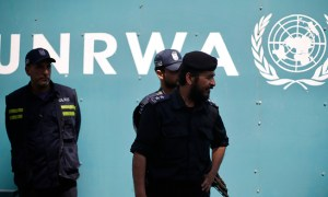 Palestinian policemen loyal to Hamas guard outside the United Nations Relief and Works Agency (UNRWA) headquarters during a protest demanding to resume financial aid for refugees, in Gaza City April 15, 2013. Robert Turner, UNRWA's director of Gaza operations, said the agency faced a $68 million shortfall in 2013 and that it had decided to cut a $40 annual handout to 106,000 Gaza refugees to save some $5.5 million. To soften the blow, the agency offered job programmes to help the poorest families. REUTERS/Mohammed Salem (GAZA - Tags: POLITICS CIVIL UNREST SOCIETY) - RTXYMBG