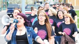Student Jessica Milford, left, leads participants in the Take Back the Night march, Friday, May 3.