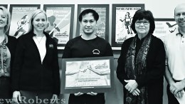 Noi Thannoi (center) poses with his winning poster alongside Executive  and Assistant Directors of the Simplot Games and CMP faculty.