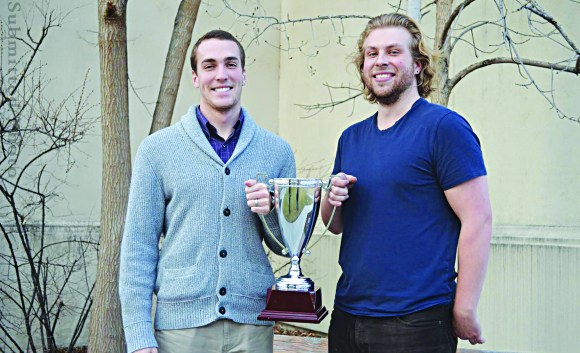 Patrick Loftus and Jason Byron pose with the RUPP Debate Society's trophy.