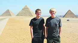 Colin and Jaxon Jensen pose before the pyramids in Egypt.