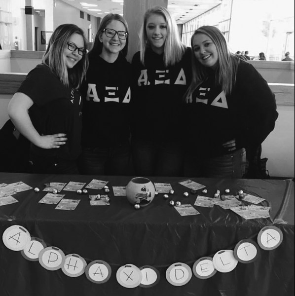 Four ladies of Alpha Xi Delta sorority