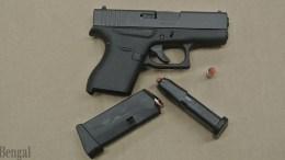 Handgun with two magazines